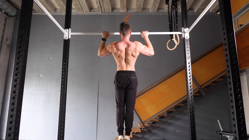 Is it best to arch the lower back or keep a hollow body position?